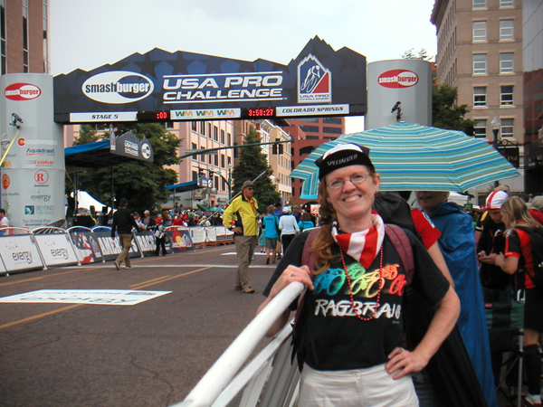 A fan waiting at the finish line in Colorado Springs on Friday to catch the riders coming in from Breckenridge